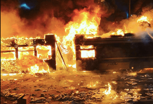 Looters Set Fire To Semi and Bus in Oakland